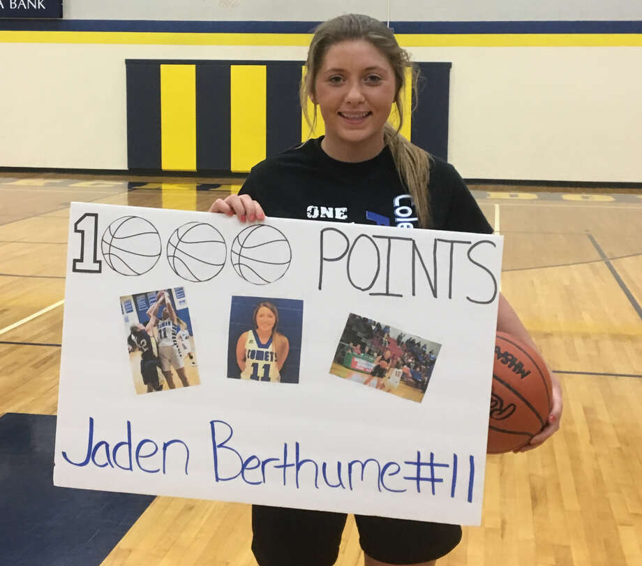 Coleman's Jaden Berthume poses with a sign commemorating her milestone 1,000th point on Tuesday at Breckenridge High School. Photo: Photo Provided
