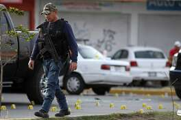 Forensic personnel work at th escene where five alleged criminals died during a confrontation with security forces of Jalisco Prosecutor's Office in Tlajomulco, Jalisco state, Mexico, on February 8, 2019. - An armed confrontation between security forces and alleged criminals left five dead and four injured in the outskirts of Guadalajara, a city in western Mexico where drug cartels are fighting over the territory, local prosecutors said. (Photo by Ulises Ruiz / AFP)ULISES RUIZ/AFP/Getty Images