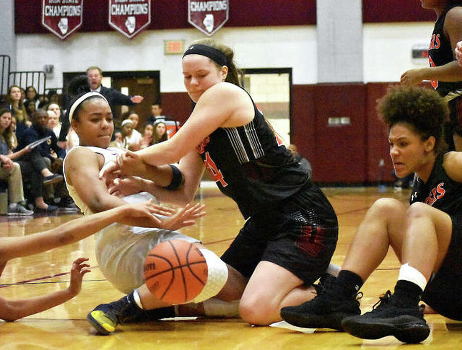 Edwardsville forward Madelyn Stephen wrestles with O'Fallon's Reyna Bullock, left, for a loose ball in second-half action Tuesday at Belleville West. Photo: Matt Kamp| For The Telegraph