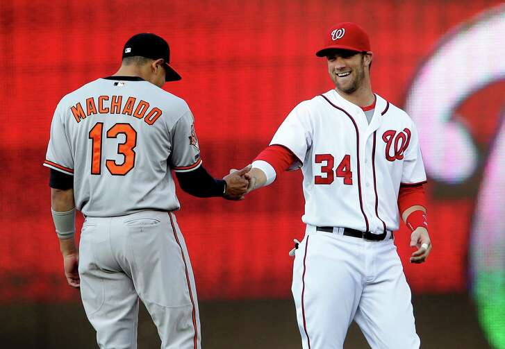 July 07 2014: Washington Nationals left fielder Bryce Harper (34) greets Baltimore Orioles third base Manny Machado (13) before a MLB game at Nationals Park, in Washington D.C. (Photo by Tony Quinn/Icon SMI/Corbis via Getty Images)