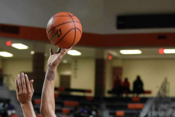 Beaumont United's Kason Harrison goes for a layup during the playoff game at La Porte High School on Tuesday night. Photo taken on Tuesday, 02/19/19. Ryan Welch/The Enterprise
