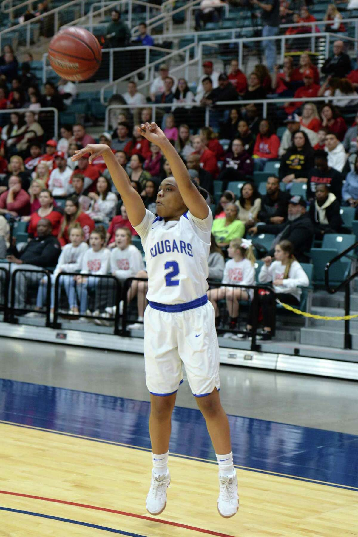 Marcayla Wortham (2) of Cy-Creek attempts a 3-point shot during the first half of a Class 6A, Region III quarterfinal basketball playoff game between the Katy Tigers and the Cy-Creek Cougars on Tuesday, February 19, 2019 at the Merrell Center, Katy, TX.
