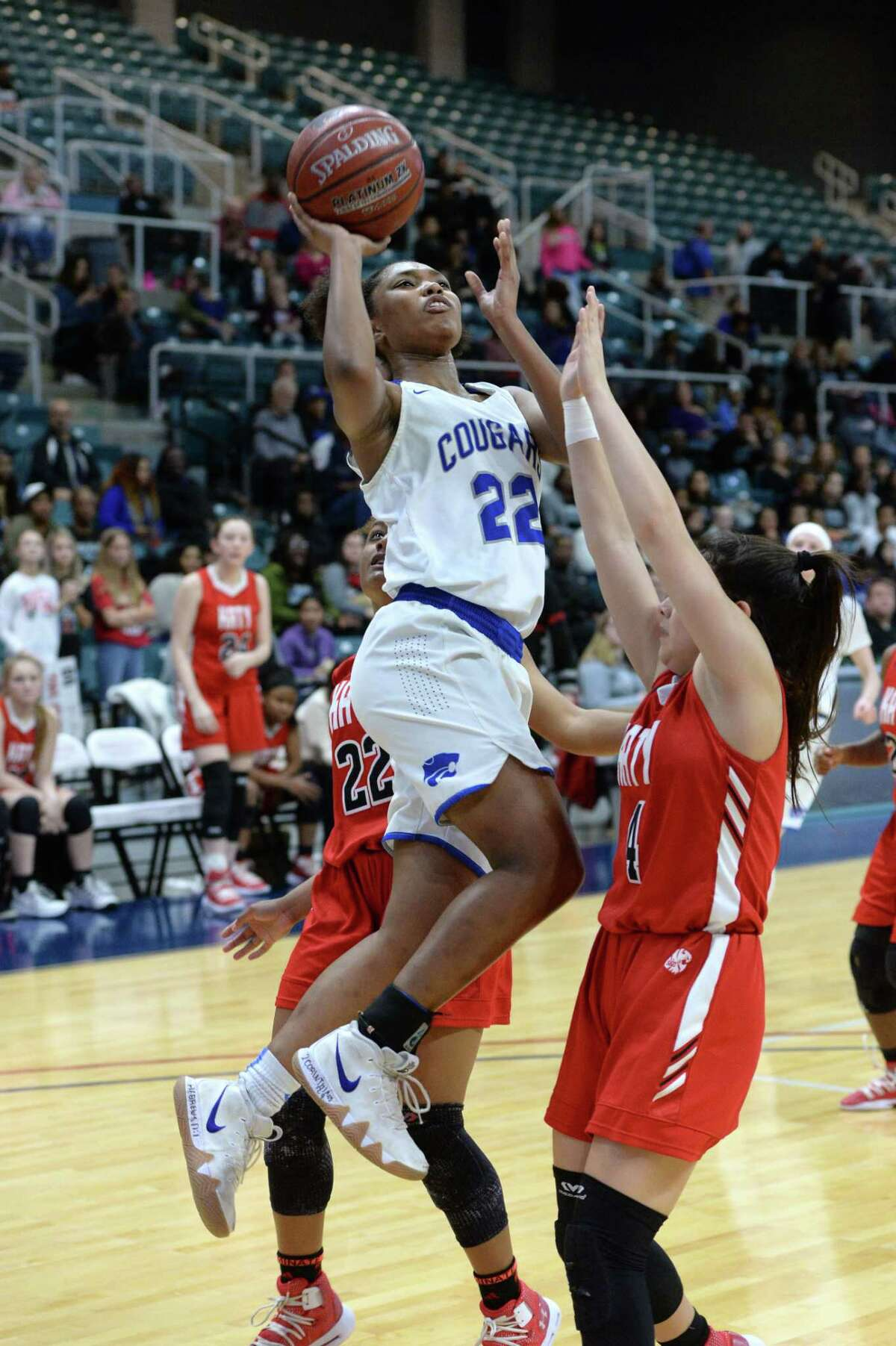 Kyndall Hunter (22) of Cy-Creek drives to the basket during the first half of a Class 6A, Region III quarterfinal basketball playoff game between the Katy Tigers and the Cy-Creek Cougars on Tuesday, February 19, 2019 at the Merrell Center, Katy, TX.