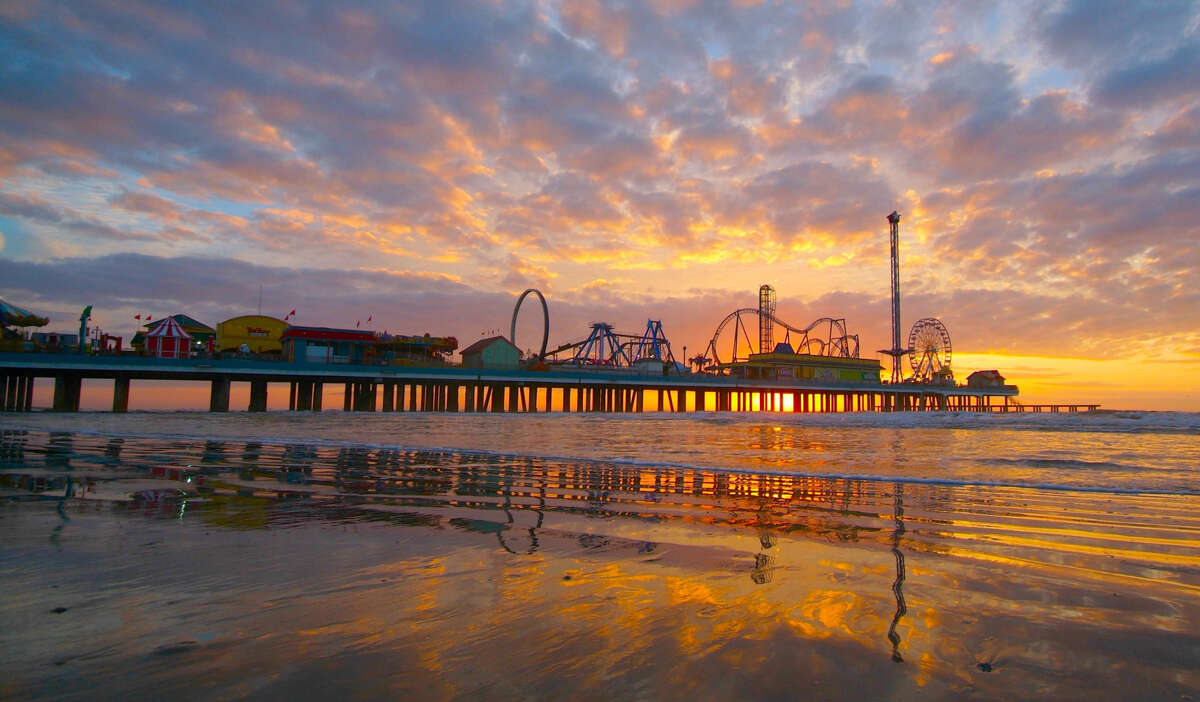 Catch a cotton candy-colored sunrise on the beach in Galveston, or a perfect sunset - this one includes the Pleasure Pier. It's gorgeous, right?