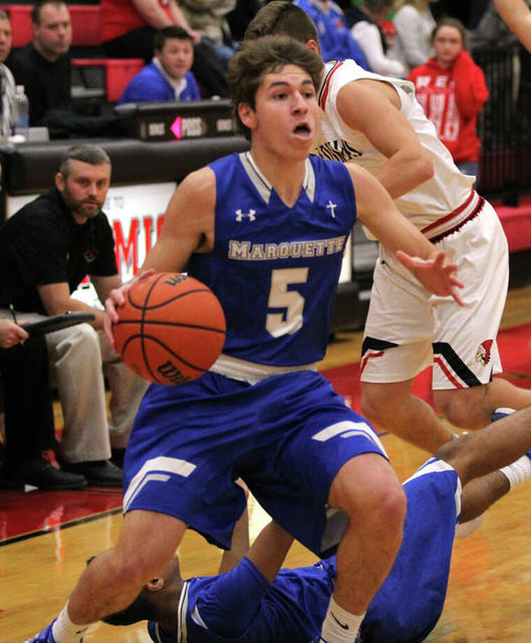 Marquette's Chris Hartrich (5) scored 15 points Tuesday in his team's 73-37 victory over Staunton in a semifinal of the Piasa Class 1A Regional at Southwestern. He is shown in action against Nokomis earlier this season. Photo: Greg Shashack File Photo | The Telegraph
