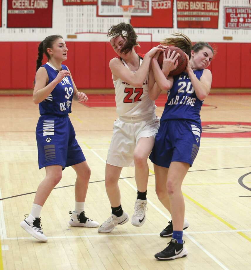Cromwell High School's Jessica DellaRatta battles Old Lyme High School's Emily DeRoehn and Anabella Arias for the ball during the girls varsity basketball game in Cromwell on Tuesday, Feb. 19. Photo: Emily J. Reynolds / For Hearst Connecticut Media / Connecticut Post Freelance