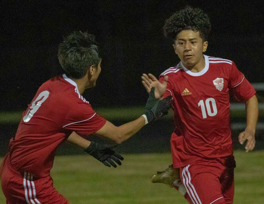 Caney Creek junior Ulysses Cruz (10) high fives Caney Creek senior Franklin Lopez (9) after scoring during a District 20-5A high school soccer game Friday, Feb. 1, 2019 at Caney Creek High School in Conroe. Photo: Cody Bahn, Houston Chronicle / Staff Photographer / © 2018 Houston Chronicle