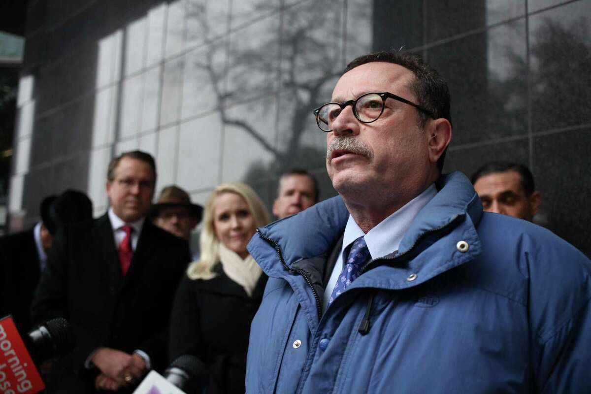 Lawyer Robert Fickman speaks in support of U.S. District Court Judge Lynn N. Hughes outside the Bob Casey United States Courthouse on Feb. 19, 2019.