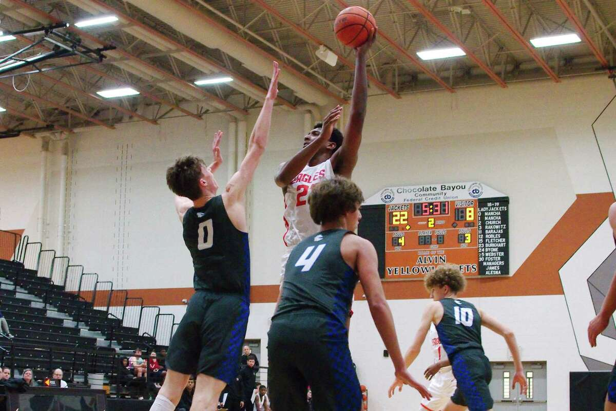 Lorenzo Waddy, top, scored 23 points to lead Dawson to a rout of Clear Springs in Tuesday's Class 6A boys bi-district playoff matchup.