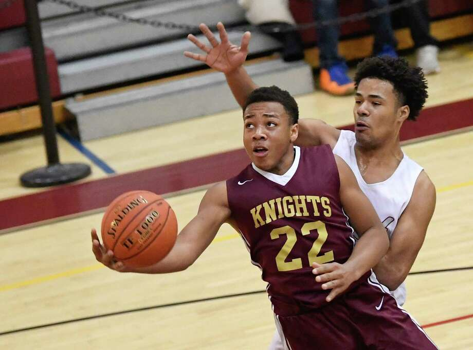 Bishop Gibbons' Rodney Parker (22) scores against Watervliet's Elijah Chambers (35) during a boys' Section II Class B high school basketball game Tuesday, Feb. 19, 2019, in Watervliet, N.Y. (Hans Pennink / Special to the Times Union) Photo: Hans Pennink / Hans Pennink