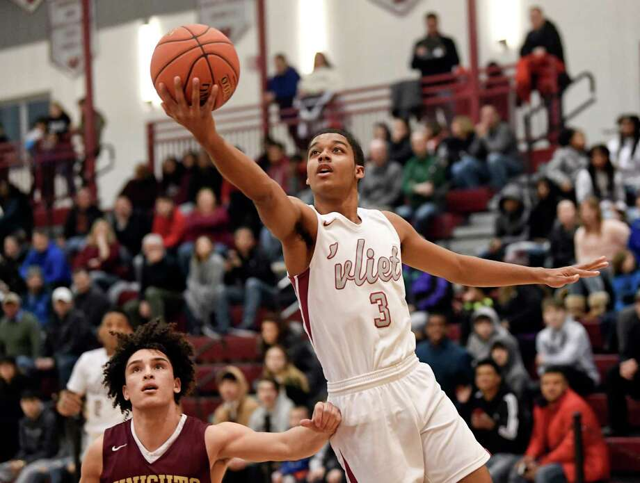 Watervliet's James Chestnut Jr. (3) scores against Bishop Gibbons during a boys' Section II Class B high school basketball game Tuesday, Feb. 19, 2019, in Watervliet, N.Y. (Hans Pennink / Special to the Times Union) Photo: Hans Pennink / Hans Pennink