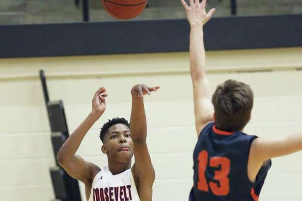Sean Moore fires a 3-pointer in Roosevelt's 61-54 second-round win over Brandeis at Littleton Gym.
