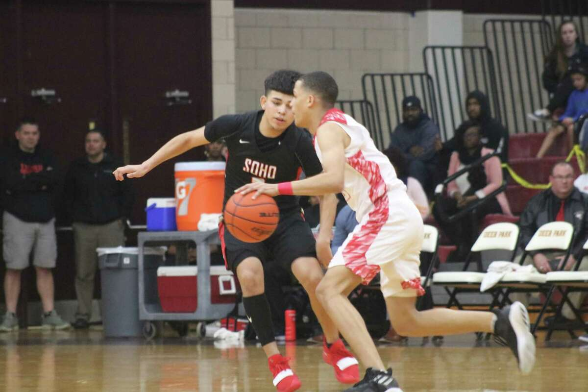 South Houston's Jido Hinojosa tries to slow the progress of North Shore's Joshua Cooper during second-half action Tuesday night.