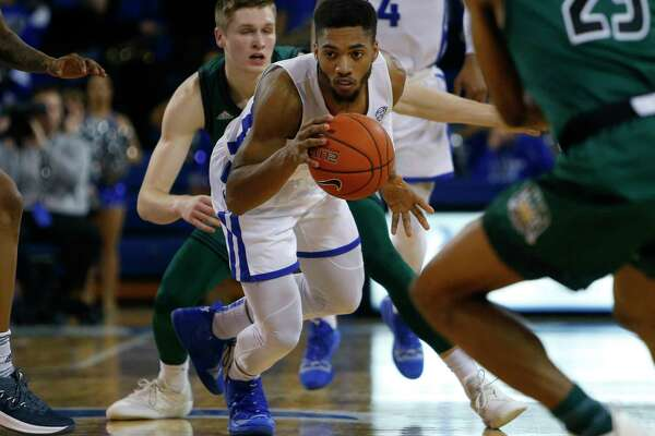 Buffalo guard Jayvon Graves (3) controls the ball against Ohio during the second half of an NCAA college basketball game, Tuesday, Feb. 19, 2019, in Buffalo N.Y. (AP Photo/Jeffrey T. Barnes)