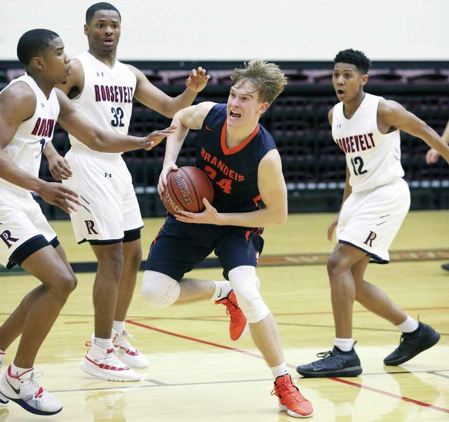 Kyle Schraeder splits a trio of defnders and gets to the lane for the Broncos as Roosevelt plays Brandeis in boys high school basketball playoffs at Littleton Gym on February 19, 2019. Photo: Tom Reel, Staff / Staff Photographer / 2019 SAN ANTONIO EXPRESS-NEWS