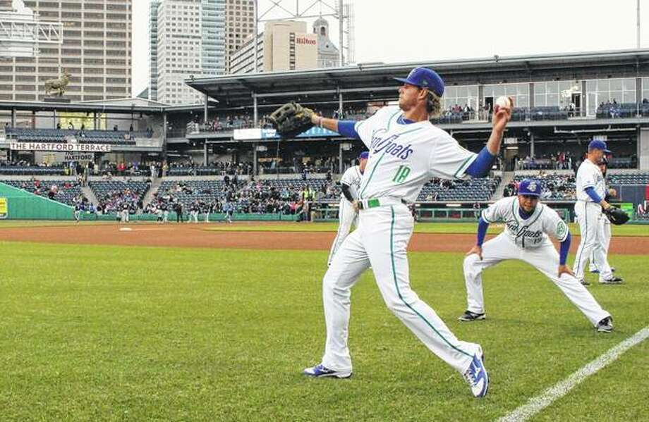 Hartford Yard Goats players warm up in April 2017 before the team's first ever game in Hartford, Connecticut. The Double-A team is going peanut-free at its 6,000-seat Dunkin' Donuts Park in 2019 to make the venue safer for people with nut allergies. Photo: Pat Eaton-Robb | Associated Press