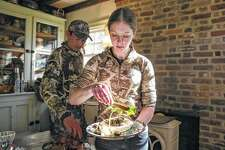 Wade Truong and Rachel Owen prepare a post-hunt lunch of Peking goose on flour tortillas smeared with hoisin sauce at home in Fredericksburg, Virginia. As the ranks of American hunters dwindle, millennials like Truong are taking up the tradition, seeking a direct connection to what they eat.