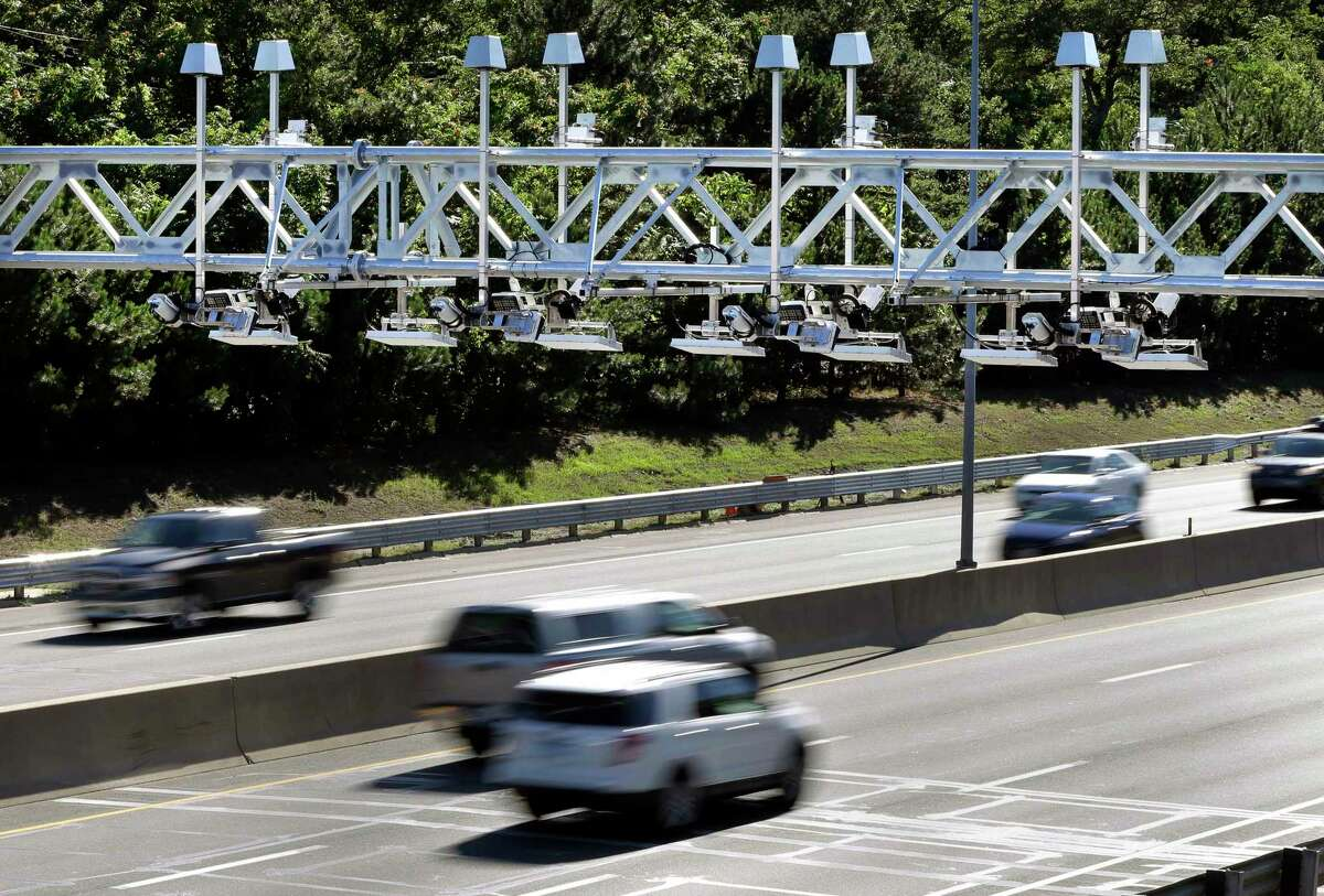 Toll sensor gantries hanging over the Massachusetts Turnpike in Newton, Mass.