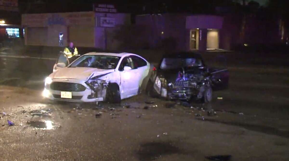 Police are looking for at least two robbery suspects who fled the scene of a crash following a police chase Tuesday night. The bystander involved in the wreck was taken to a hospital with minor injuries, police said.