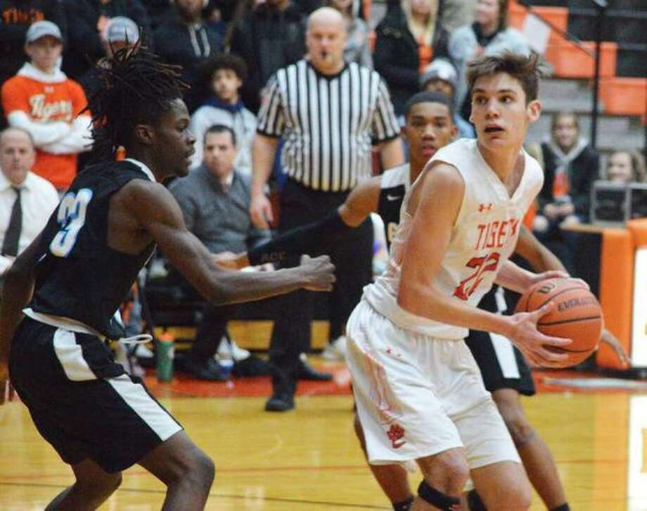 Edwardsville sophomore Brennan Weller, right, tries to get past a Gateway STEM defender during a Jan. 29 game at Lucco-Jackson Gymnasium. Photo: Scott Marion/Intelligencer