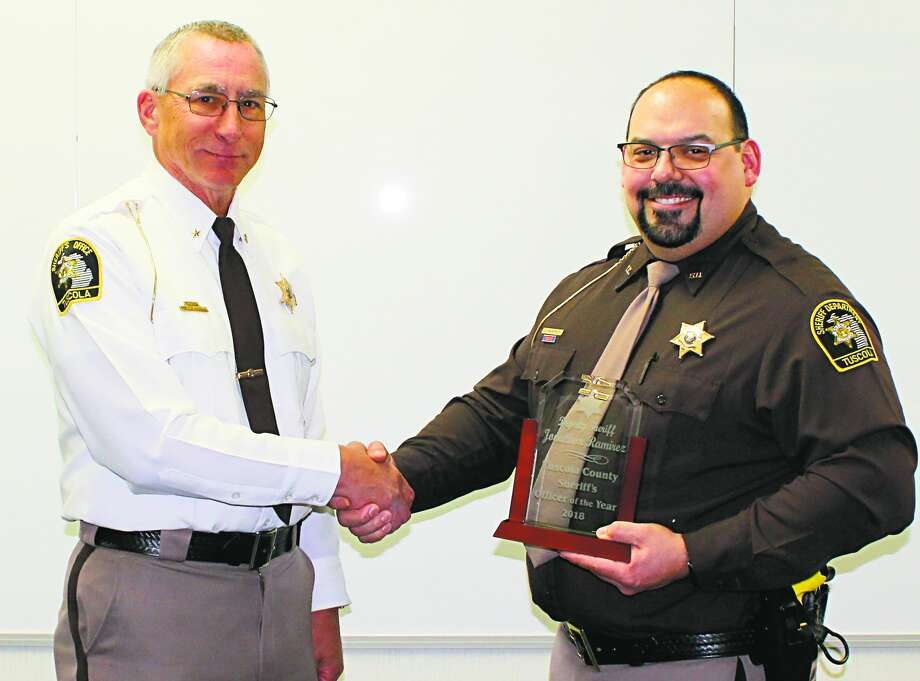 From left, Tuscola Sheriff Glen Skrent awards the department's Officer of the Year honors to Deputy Jonathon Ramirez, who also received a citation for bravery. Photo: Courtesy Photo