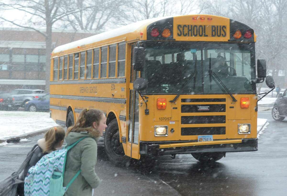 A school bus departs Eastern Middle School after an early dismissal due to snow in the Riverside section of Greenwich, Conn. Tuesday, Jan. 31, 2017.