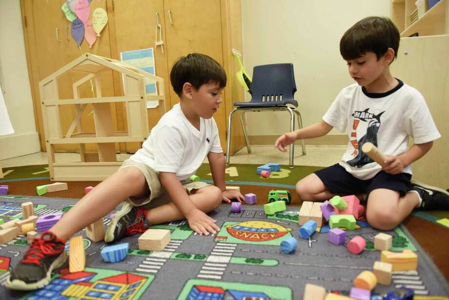 Sebastian Alcala, left, and Luca Bongiolo play at Gateway School in Greenwich on Aug. 8, 2018. Family Centers, which received a $125,000 grant from the Greenwich United Way, operates the all-day, all-year preschool. Photo: Tyler Sizemore / Hearst Connecticut Media / Greenwich Time