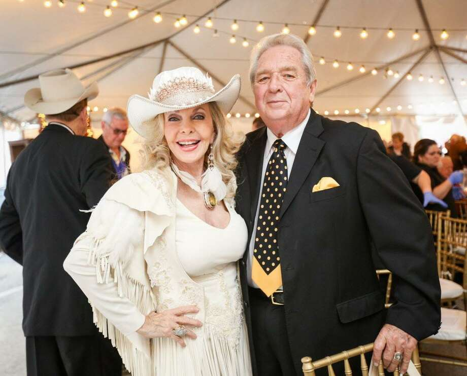 Lyn and Carl Howard are pictured during the Bach, Beethoven and Barbecue Gala on Saturday, March 10, 2018, outside of Martin's Hall in downtown Conroe. Lyn Howard will again be the auctioneer at the March 9 Bach, Beethoven and Barbecue gala. Photo: Michael Minasi, Staff Photographer / Houston Chronicle / © 2018 Houston Chronicle