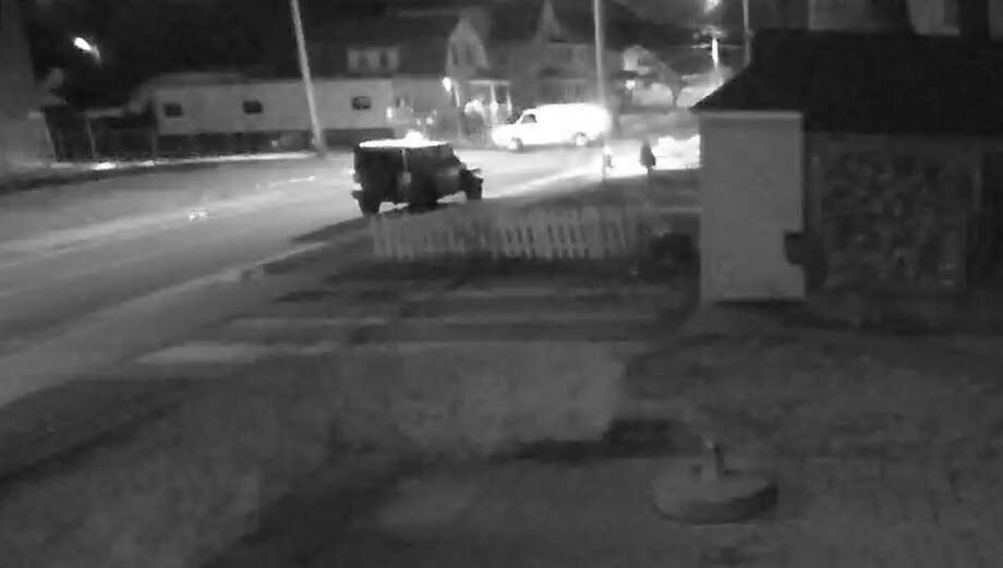 A screen shot showing the white vehicle East Haven police are seeking Photo: East Haven Police