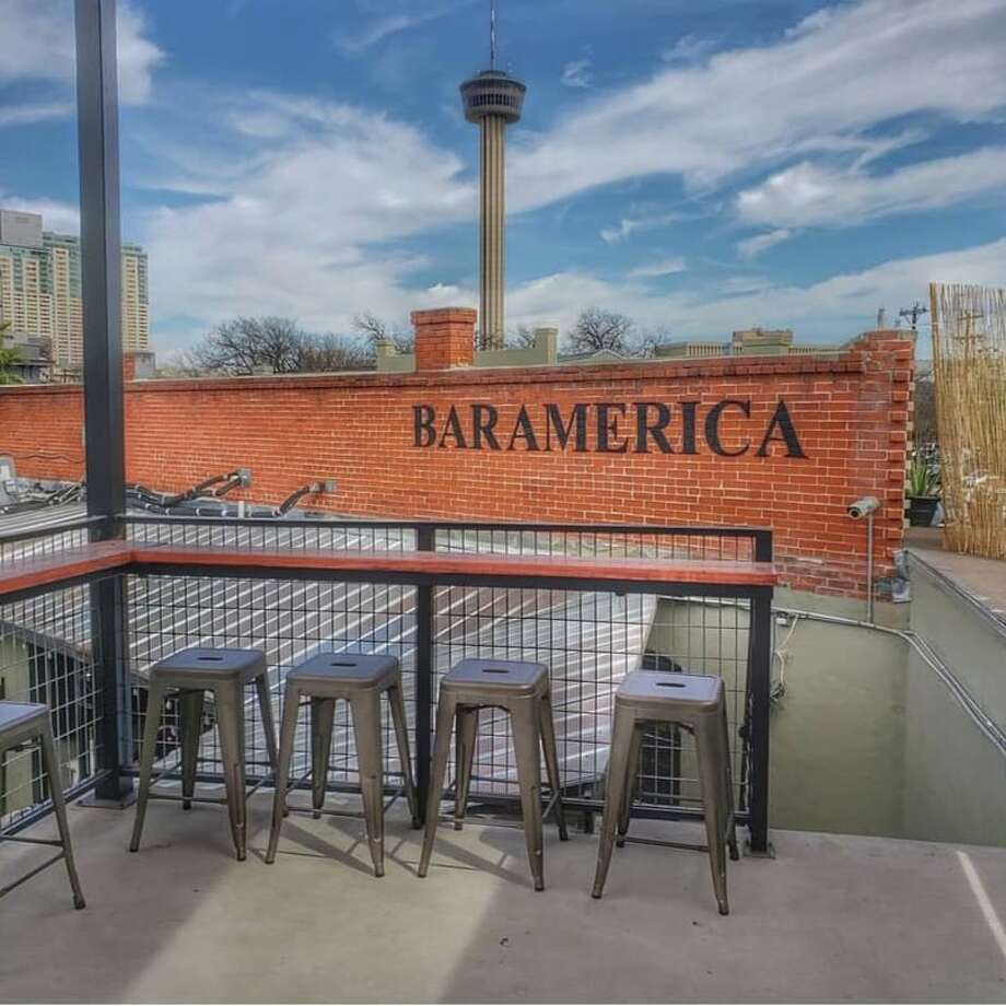 "While the 77-year-old hangout is proud of incorporating elements that were around when the first drink was poured in 1942, like the neon ""Bar America"" sign that overlooks the dance floor, the space is now up-to-date with the city's growing mural scene and rooftop patio trend. Photo: Courtesy, Bar America"