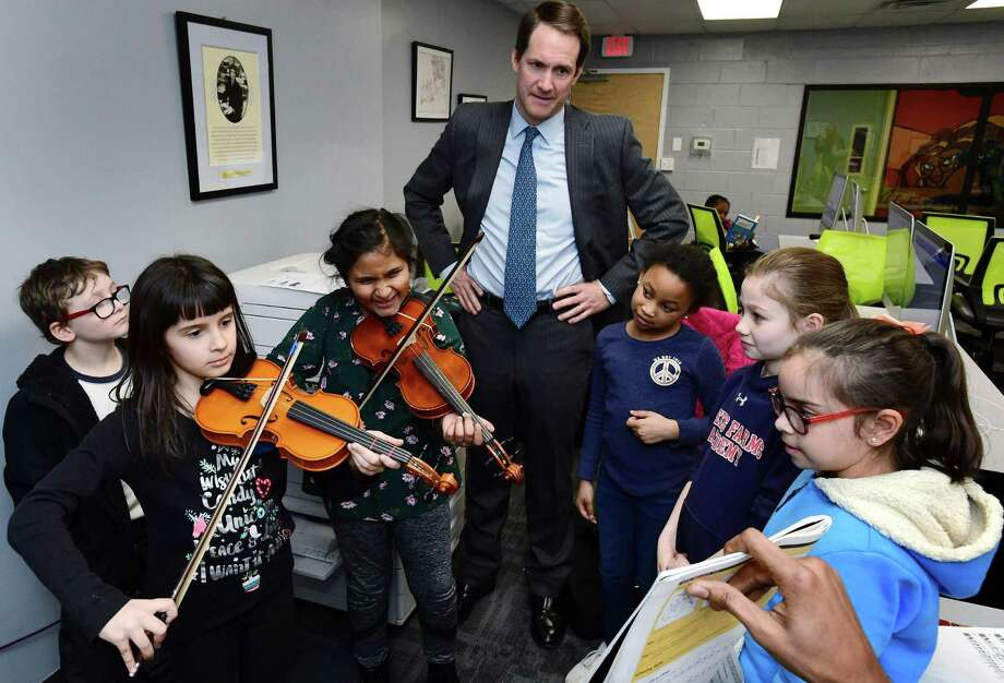 US Congressman Jim Himes (D-CT) visits the Carver Community Center and meets with students including Ian Greenman, Bailey Varley-Reid, 8, Rachel Jospeh, 8, Ariel Stover, 8, Daniela Garcia, 8, and Sophia Stapleton, 9, Tuesday, February 19, 2019, in Norwalk, Conn. The Carver Foundation is Norwalk's largest provider of afterschool programs for middle and high school students and the largest provider of summer programs for K through 9th grade students. Photo: Erik Trautmann / Hearst Connecticut Media / Norwalk Hour