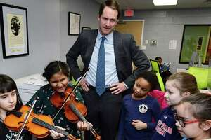 US Congressman Jim Himes (D-CT) visits the Carver Community Center and meets with students including Ian Greenman, Bailey Varley-Reid, 8, Rachel Jospeh, 8, Ariel Stover, 8, Daniela Garcia, 8, and Sophia Stapleton, 9, Tuesday, February 19, 2019, in Norwalk, Conn. The Carver Foundation is Norwalk's largest provider of afterschool programs for middle and high school students and the largest provider of summer programs for K through 9th grade students.