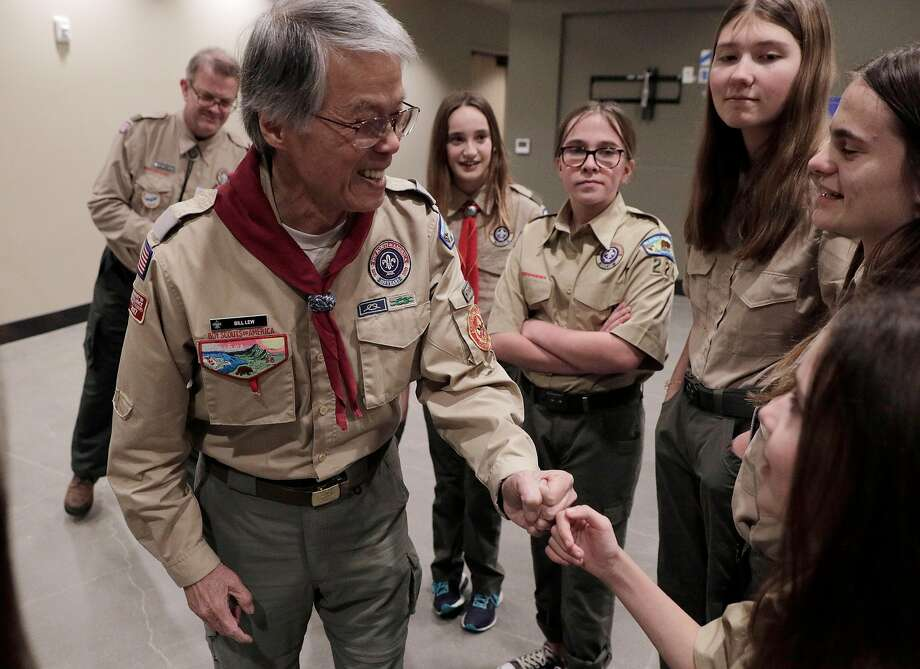 Scout unit Commissioner Bill Lew fist-bumps Ashlyn Weber before a Scouts BSA ceremony welcoming girls as new members at St. Perpetua Church in Lafayette. The organization formerly known as the Boy Scouts of America began admitting girls on Feb. 1, and one of the Bay Area's first Scout troops of girls is already going full speed in Lafayette, with Troup 224. Photo: Carlos Avila Gonzalez / The Chronicle