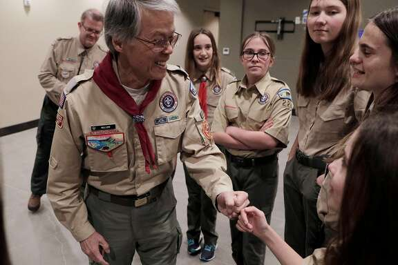 Scout unit commissioner, Bill Lew, fist bumps Ashlyn Weber, before a Scouts BSA meeting welcoming in the new girl members at St. Perpetua Church in Lafayette, Calif., on Monday, February 11, 2019.  The organization formerly known as the Boy Scouts of America began admitting girls on Feb. 1, and one of the Bay Area's first Scout troops of girls is already going full-speed in Lafayette, with Troup 224.
