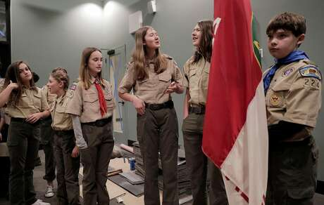 Zoe Braunstein (left), Dakota Goyert, Caitlin Crinnion, Catherine Bronte, Caroline Bronte and Jacob Tuckerman line up to enter a Scouts BSA ceremony at St. Perpetua Church in Lafayette. The organization formerly known as the Boy Scouts of America began admitting girls on Feb. 1, and one of the Bay Area's first Scout troops of girls is already going full speed in Lafayette, with Troup 224. Photo: Carlos Avila Gonzalez / The Chronicle