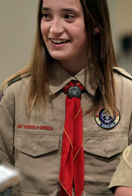 Caitlin Crinnion gets ready for a Scouts BSA ceremony at St. Perpetua Church in Lafayette. The organization formerly known as the Boy Scouts of America began admitting girls on Feb. 1, and one of the Bay Area's first Scout troops of girls is already going full speed in Lafayette, with Troup 224. Photo: Carlos Avila Gonzalez / The Chronicle