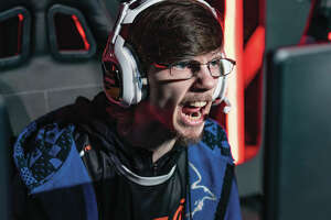 "Esports professional player Justin ""Pistola"" Deese, for team Reciprocity, competes intensely at The HaloClassic, which awarded a $35,000 prize pool to the top eight teams. Four players are on each team; 90 teams competed in the three-day tournament Jan. 11-13."