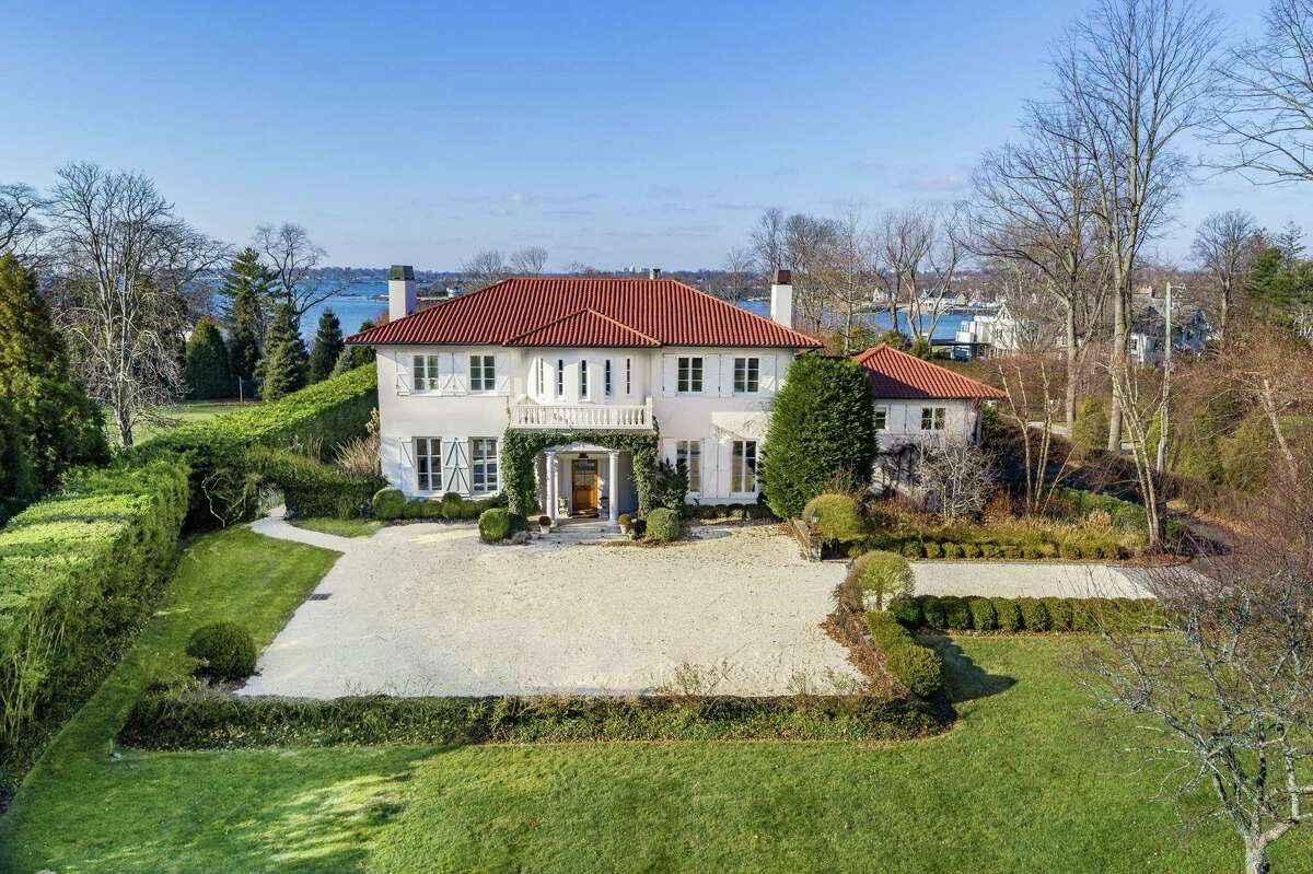 The French-inspired villa at Darien's 174 Long Neck Point Road is sited on 1.01 level acres on a peninsula.