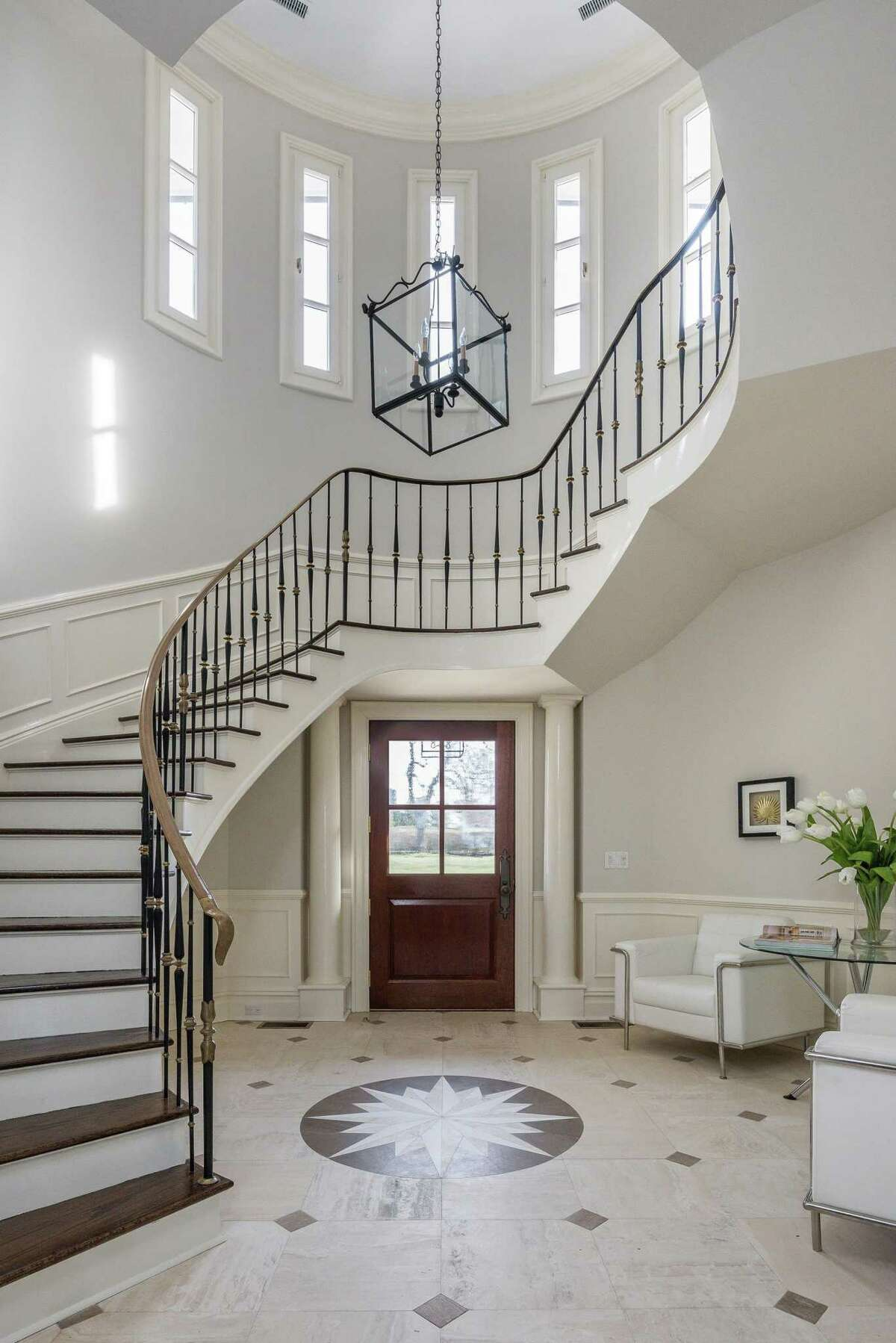 The entrance hall at the Darien home soars 24 feet high with a marble floor.
