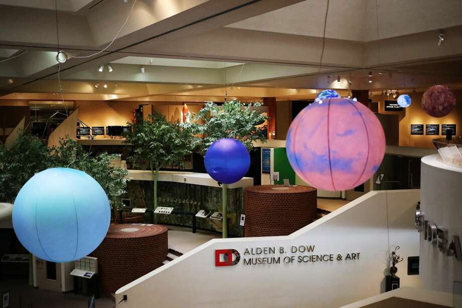 Large inflatable spheres depicting the moon and several planets are  part of a new outer space-themed exhibit at the Alden B. Dow Museum of  Science & Art. (Katy Kildee/kkildee@mdn.net) Photo: (Katy Kildee/kkildee@mdn.net)