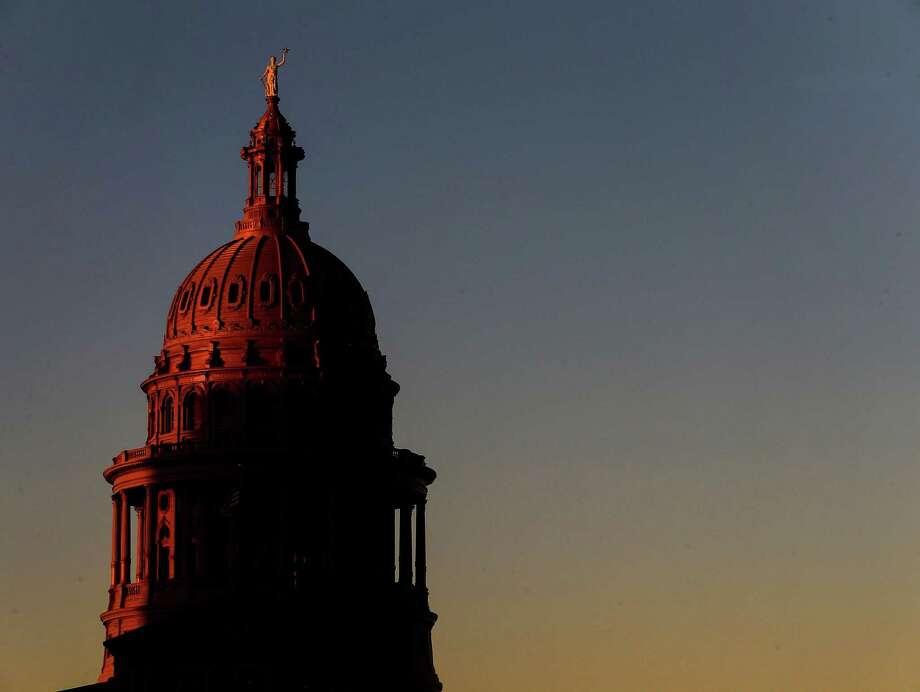 The sun sets over the Texas Capitol Tuesday, Oct. 11, 2016, in Austin. ( Jon Shapley / Houston Chronicle ) Photo: Jon Shapley, Staff / Houston Chronicle / Stratford Booster Club