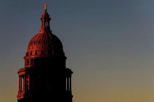 The sun sets over the Texas Capitol Tuesday, Oct. 11, 2016, in Austin. ( Jon Shapley / Houston Chronicle )