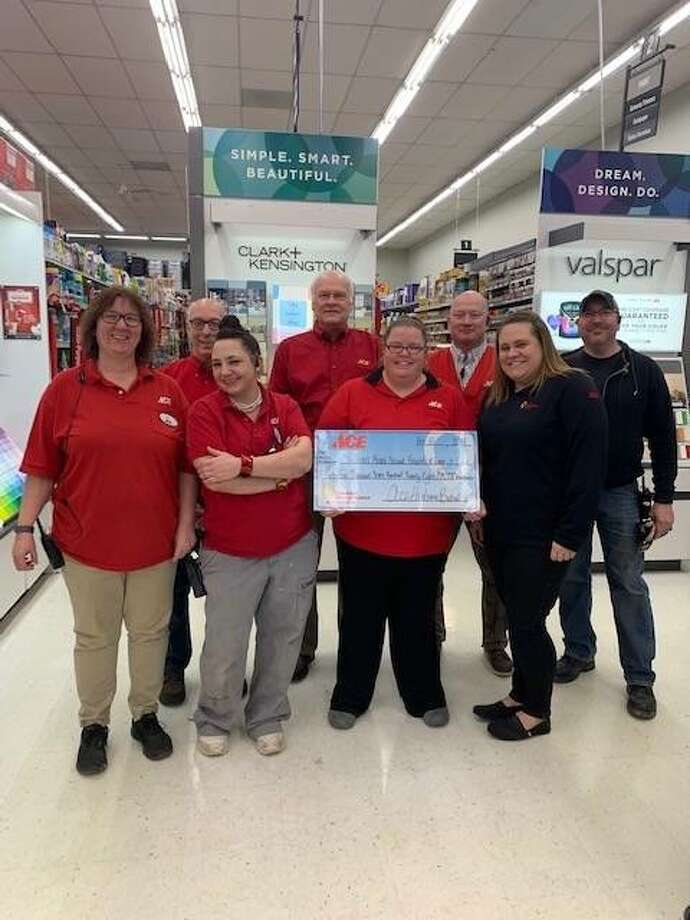 Employees at Bethalto Ace Hardware present the $34,727 they raised throughout 2018 for children's hospitals in the St. Louis area. Photo: Photo Courtesy Of Molly Mathias