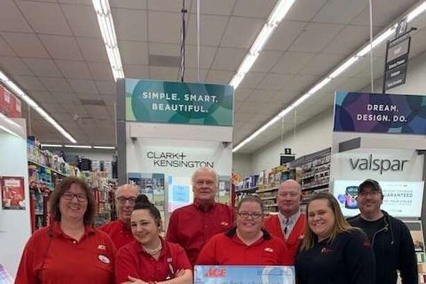 Employees at Bethalto Ace Hardware present the $34,727 they raised throughout 2018 for children's hospitals in the St. Louis area.