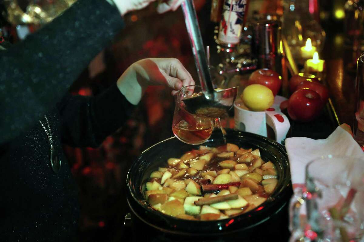 Debbie Miller pours a Hot Apple Brandy Cider at the Royal Cuckoo in S.F.
