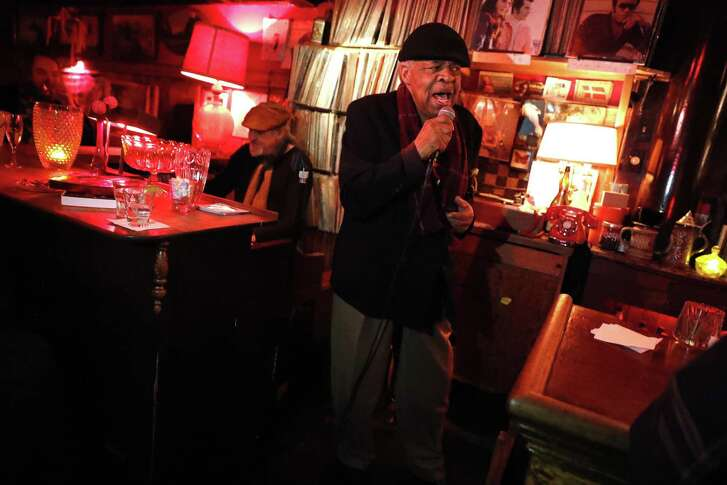 Freddie Hughes, 75, sings as Chris Burns plays the organ at the Royal Cuckoo in S.F.