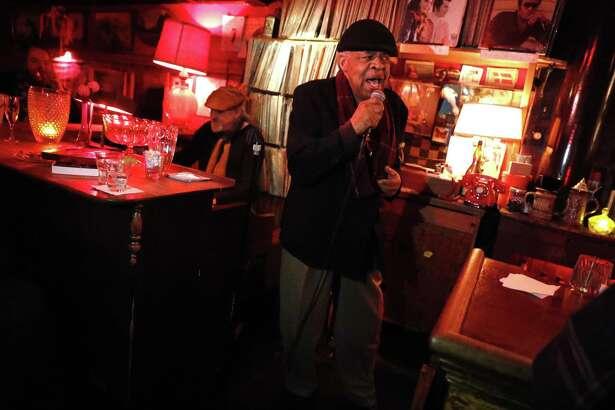 Freddie Hughes, 75, sings as Chris Burns plays the organ at the Royal Cuckoo in S.F.