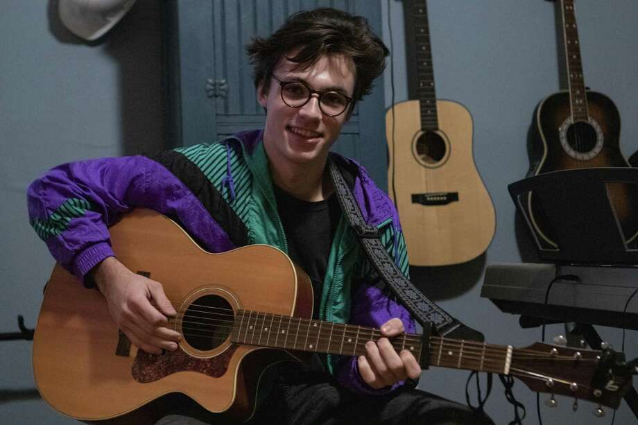 The Haps, a student band led by Peter McPoland, is headlining the festival. The Woodlands High School senior Peter McPoland sits with his guitar Thursday, Jan. 10, 2019 at his home in Spring. McPoland has several singles on Spotify. Photo: Cody Bahn, Houston Chronicle / Staff Photographer / © 2018 Houston Chronicle