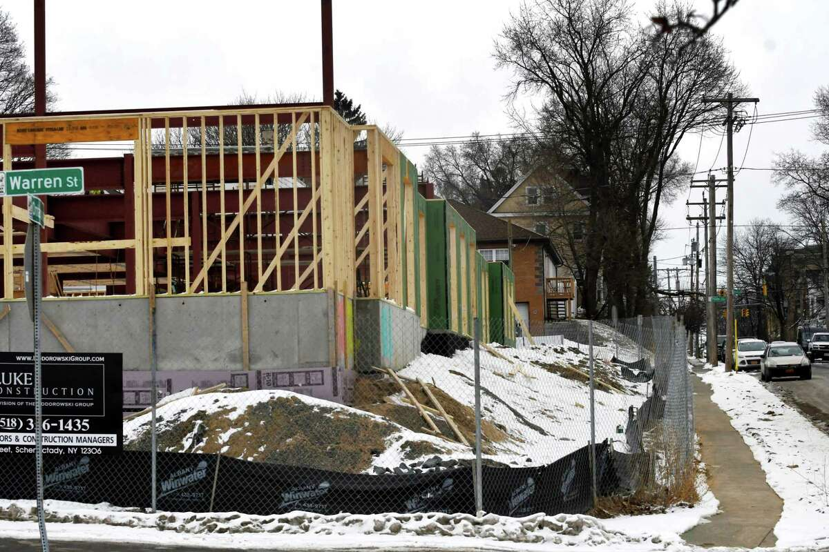 Construction work continues on a apartment complex at the former Playdium bowling alley location on Ontario Street on Wednesday, Feb. 20, 2019, in Albany, N.Y. The development consists of three four-story buildings that will include 109 apartments and between 4,000 and 6,000 square feet of retail space. (Will Waldron/Times Union)