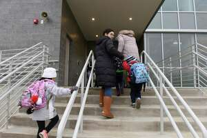 Students enter on the first day of school at the new New Lebanon School in the Byram section of Greenwich, Conn. Feb. 20, 2019. Students were welcomed with festivities featuring those closely involved with the construction of the new building. After the welcome assembly, students proceeded to a normal school day.